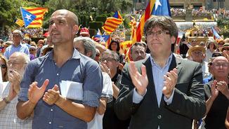 Pep Guardiola i Carles Puigdemont, en un acte a favor del referèndum
