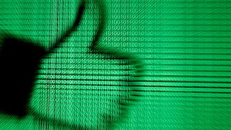 """El símbol del """"like"""" de Facebook reflectit en dades binàries (Reuters)"""
