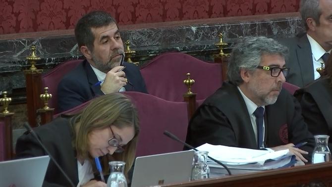 Jordi Sànchez escolta la declaració del testimoni del tinent de la guàrdia civil del 20S
